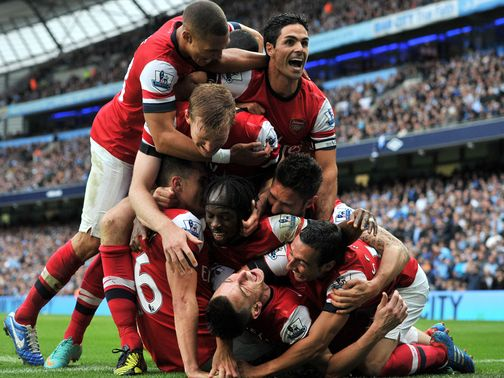 Arsenal celebrate their late leveller