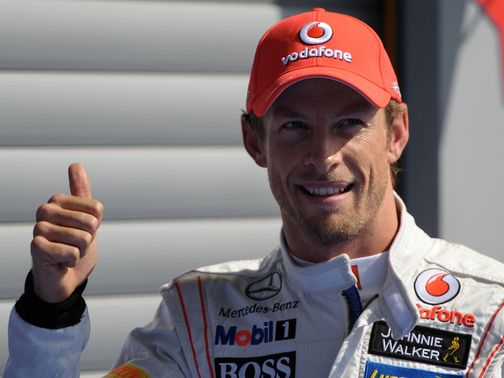 Jeson Button celebrates claiming pole position