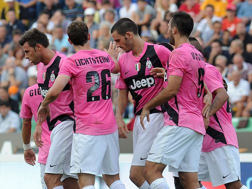 Mirko Vucinic is mobbed by his Juventus team-mates
