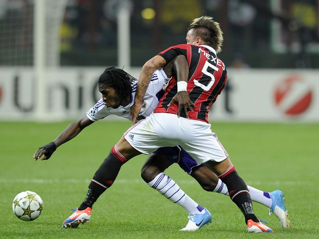 Philippe Mexes and Dieudonne Mbokani battle for the ball