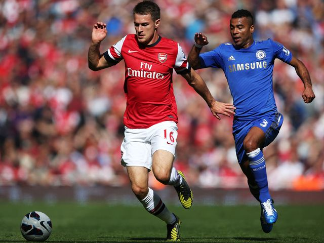 Aaron Ramsey takes on Ashley Cole