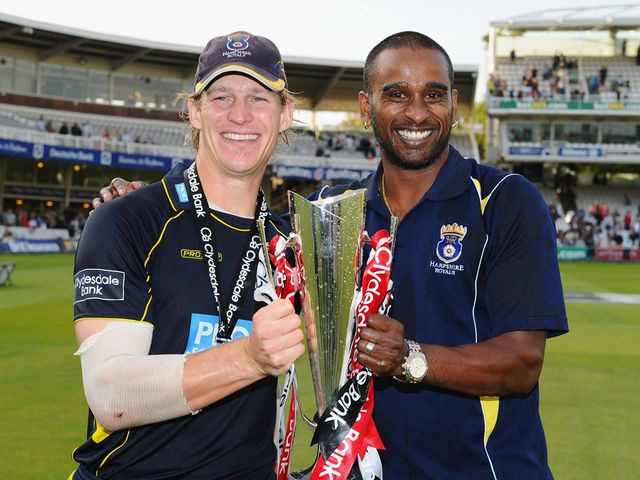 Adams and Mascarenhas celebrate with the trophy