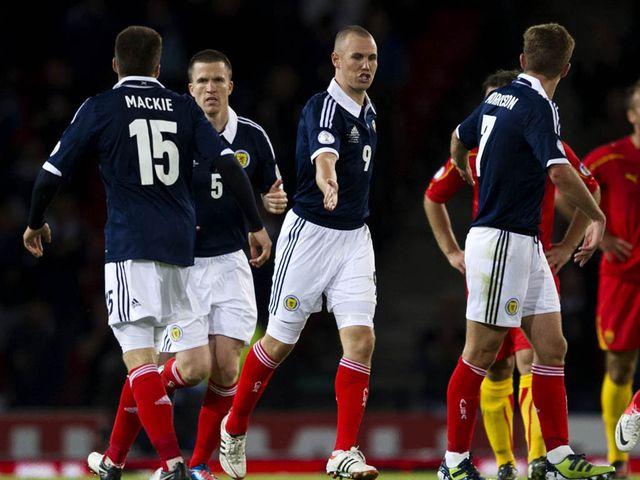 Miller celebrates scoring Scotland's equalising goal