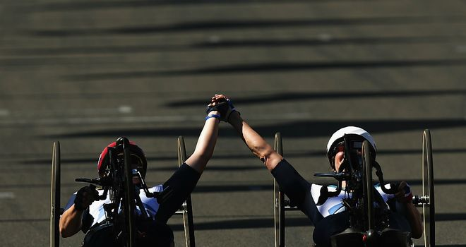 Great Britain team-mates Rachel Morris and Karen Darke finish together