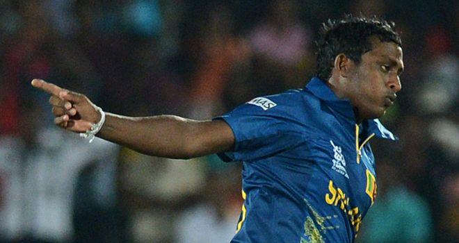 Flying start: Ajantha Mendis celebrates his record-breaking effort against Zimbabwe