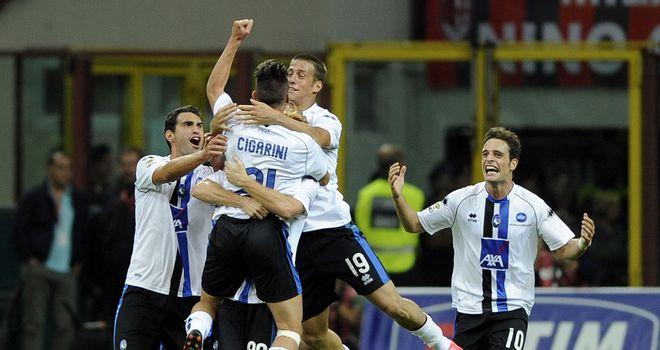 Atalanta celebrate Luca Cigarini's goal
