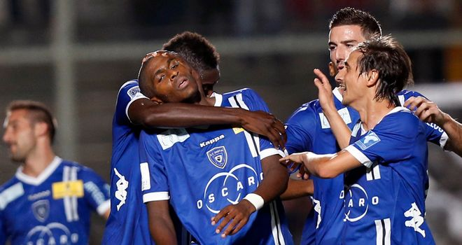 Bastia celebrate Anthony Modeste's equaliser.