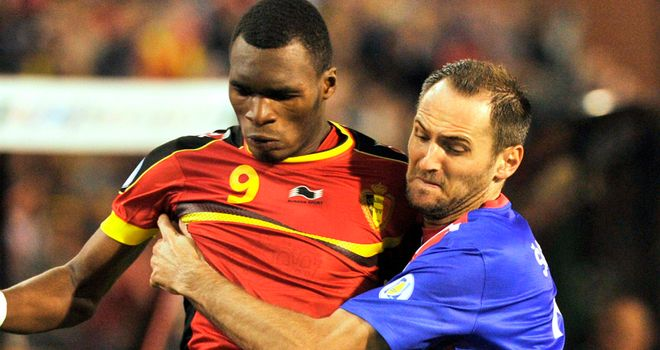 Christian Benteke and Josip Simunic tangle.