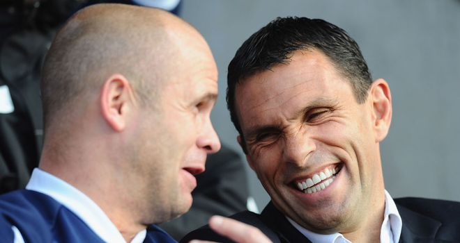 Strength in adversity: Charlie and Gus Poyet have forged a strong working relationship