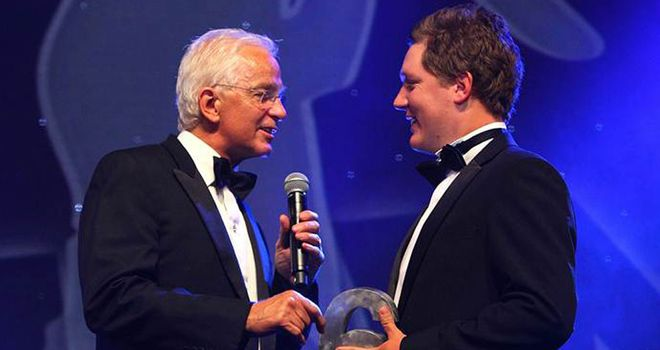 Ballance receives his award from Sky Sports presenter David Gower