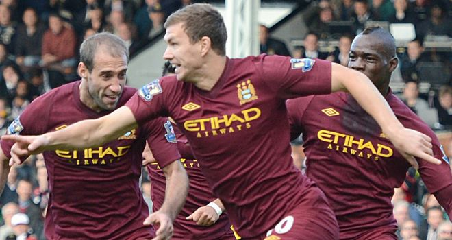 Edin Dzeko: Celebrates his winner at Fulham