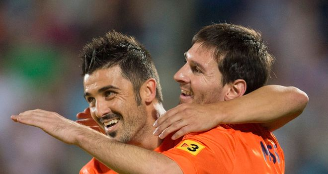 David Villa and Lionel Messi celebrate during Barcelona's 4-1 win at Getafe