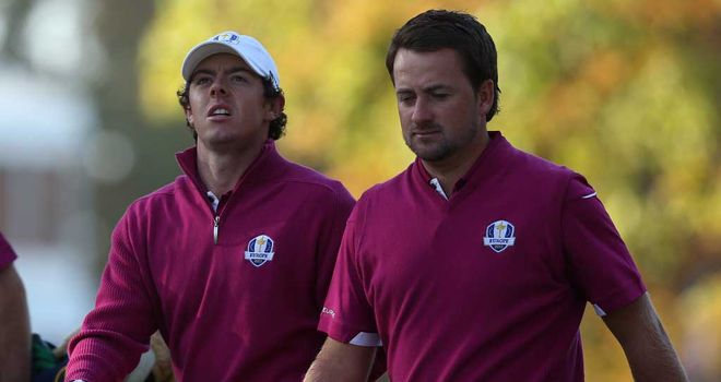 Rory McIlroy and Graeme McDowell: defeated on the 18th green