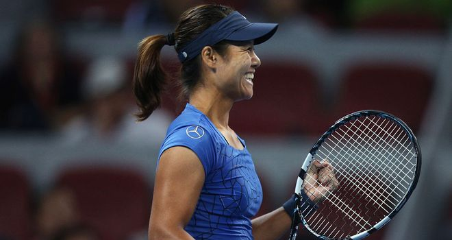 Li Na advances into round two in Beijing