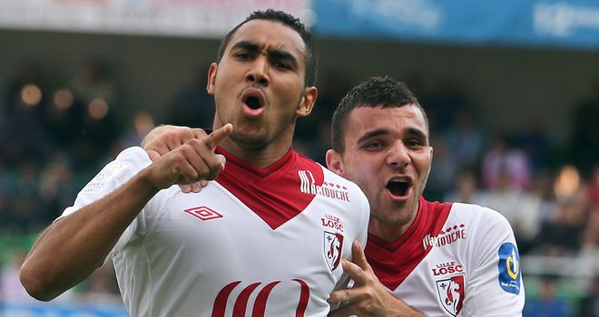 Payet (l) celebrates putting Lille ahead