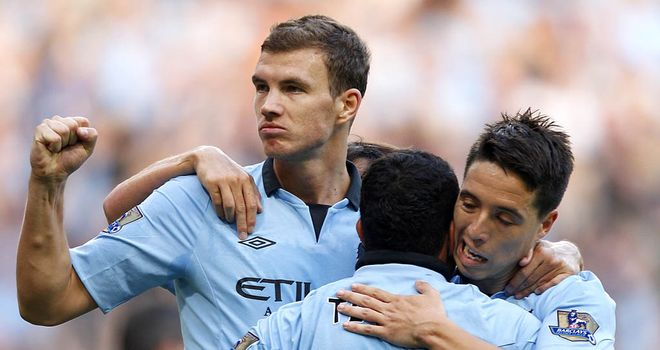 Edin Dzeko: Working hard to force his way into starting XI