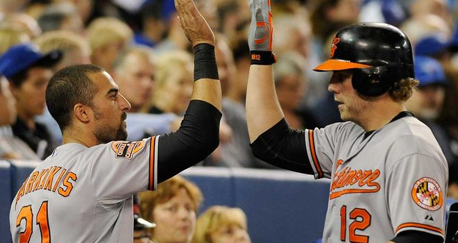 Mark Reynolds (right): congratulated after his home run for the Baltimore Orioles