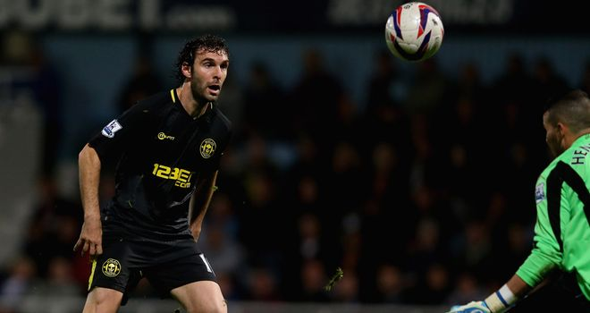 Mauro Boselli chips home his second goal of the night in Wigan's win at West Ham