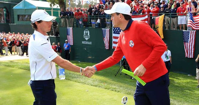 Rory McIlroy shakes hands with Keegan Bradley on the first tee