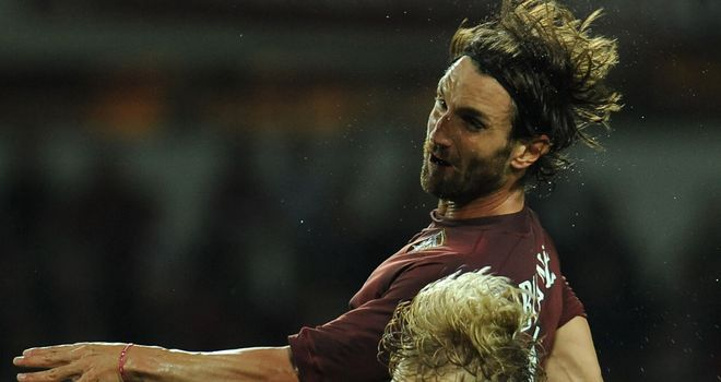 Rolando Bianchi clatters into Dusan Basta