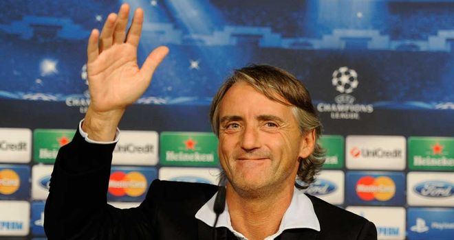 Roberto Mancini: Determined to help Manchester City progress past the group phase