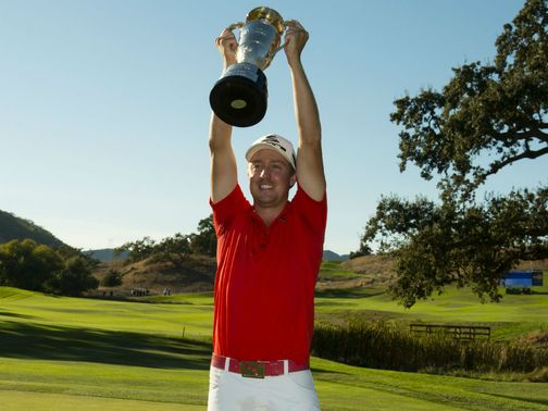 Jonas Blixt celebrates with his trophy.