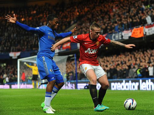 Buttner keeps the ball away from Sturridge.