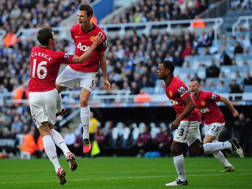Jonny Evans celebrates a goal for Manchester United