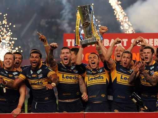 Kevin Sinfield lifts the Super League trophy once again