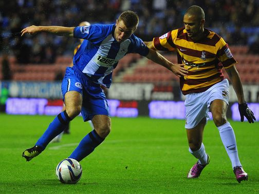 Callum McManaman and James Meredith battle for the ball
