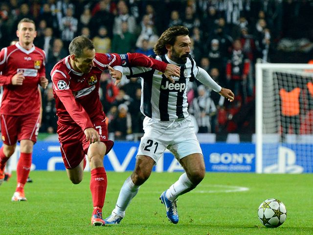 Andrea Pirlo holds off Nicolai Stokholm