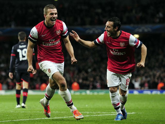 Lukas Podolski and Santi Cazorla celebrate for Arsenal