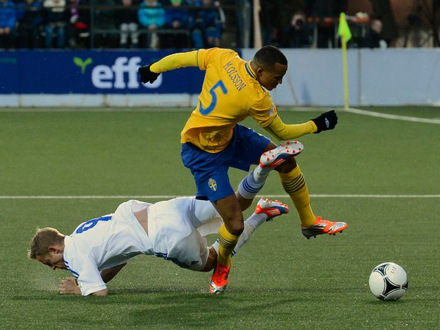 Martin Olsson moves away from Daniel Udsen.