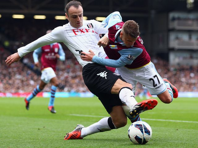 Dimitar Berbatov tackles Joe Bennett