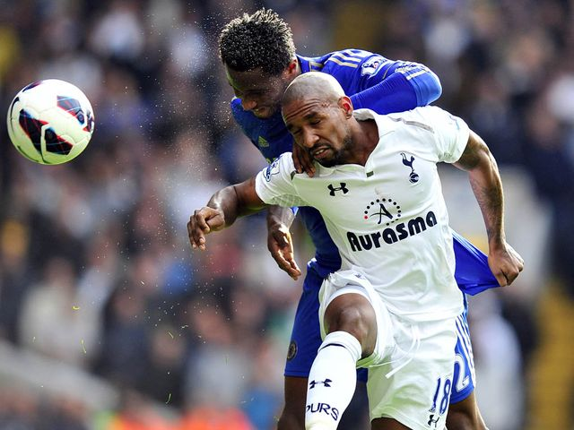 Mikel and Defoe in aerial battle