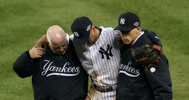 New York Yankees shortstop Derek Jeter is helped from the field with a broken ankle