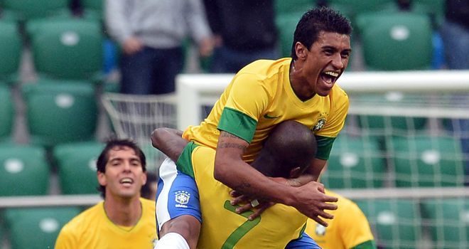 Paulinho: Celebrates his goal for Brazil