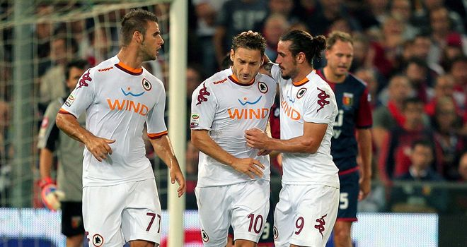 Totti takes the congratulations after his goal