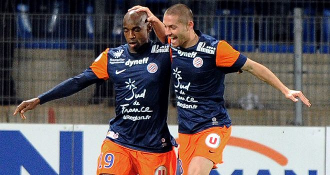 Montpellier's Souleymane Camara (L) and Anthony Mounier celebrate
