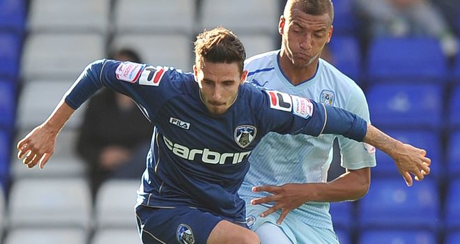 Matt Derbyshire: Will be staying at Oldham on loan, says manager Dickov