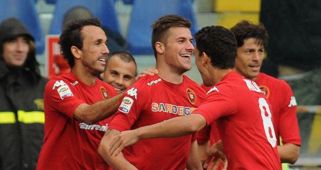 Cagliari celebrate Daniele Dessena's winner.
