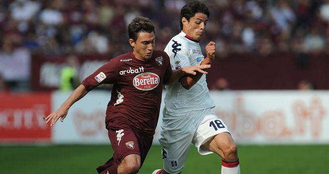 Matteo Darmian vies with Nene