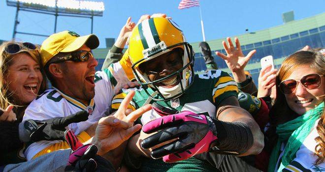 Donald Driver: celebrates his fourth-quarter touchdown with the Lambeau faithful