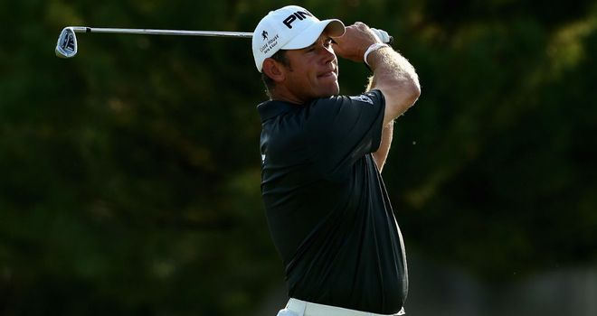 Lee Westwood: carded six birdies on a blistering back nine to beat Charl Schwartzel by six strokes