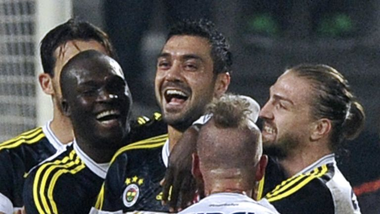 Bekir Irtegun is mobbed after scoring the winning goal for Fenerbahce
