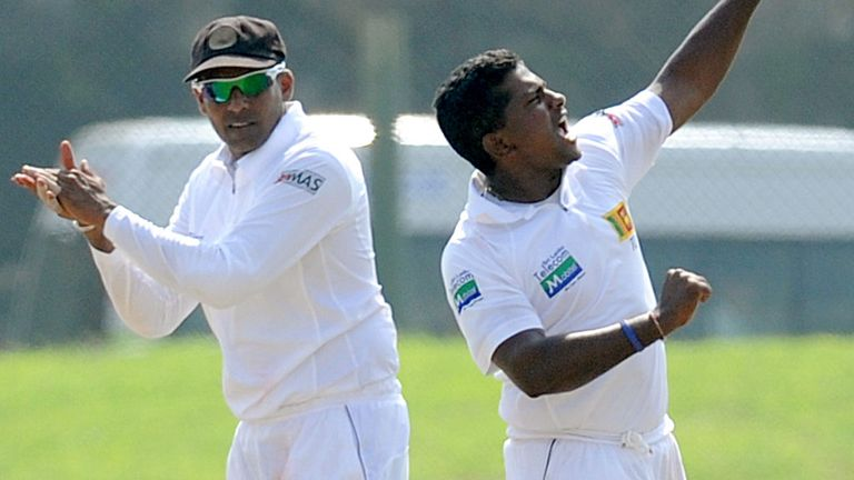 Rangana Herath (R) celebrates another Sri Lanka wicket with Thilan Samaraweera