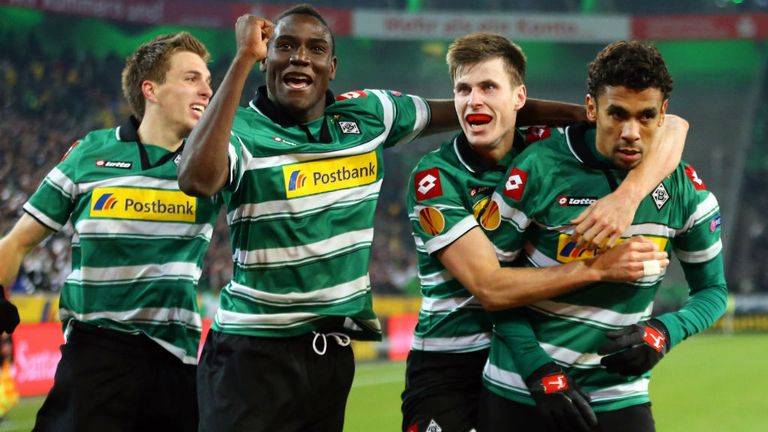 Borussia celebrate with Igor de Camargo (right) after one of his two goals