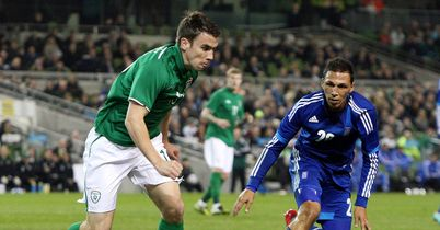 Seamus Coleman: Is tracked by Loint Cholevas during the Republic of Ireland's 1-0 loss to Greece