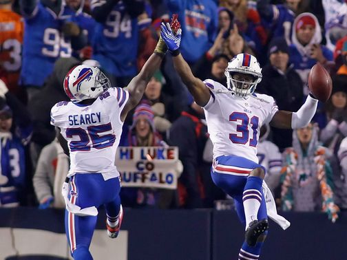 DaNorris Searcy and Jairus Byrd celebrate
