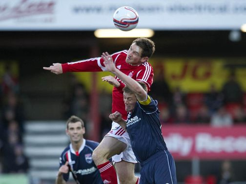 Scott Vernon leaps above Richard Brittain